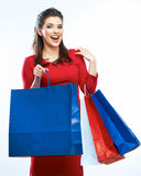 Het winkelen de zakken van de vrouwengreep, geïsoleerd portret Witte achtergrond Stock Fotografie