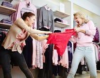 Het winkelen geweld Stock Foto