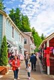 Het Winkelen Ketchikan van de Promenade van de Straat van de Kreek van Alaska Stock Foto's