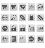 Het winkelen pictogrammen op grijze vierkanten Stock Foto