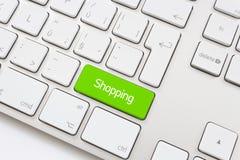 Het winkelen sleutel met karretjepictogram Stock Afbeelding