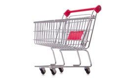 Het winkelen supermarktkarretje op het wit wordt geïsoleerd dat Royalty-vrije Stock Afbeeldingen