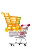 Het winkelen supermarktkarretje op het wit wordt geïsoleerd dat Royalty-vrije Stock Foto