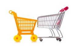 Het winkelen supermarktkarretje op het wit wordt geïsoleerd dat Royalty-vrije Stock Fotografie