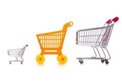 Het winkelen supermarktkarretje op het wit wordt geïsoleerd dat Stock Foto's