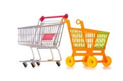 Het winkelen supermarktkarretje op het wit wordt geïsoleerd dat Stock Foto