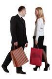 Het winkelen van de man en van de vrouw Stock Afbeelding