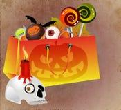Het winkelen van Halloween zak met enge gezicht en snoepjes Stock Afbeelding