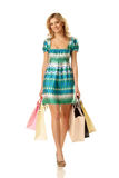 Het winkelen vrouw het lopen Royalty-vrije Stock Foto's