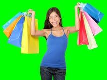 Het winkelen vrouwenholding het winkelen zakken royalty-vrije stock afbeelding