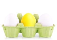 Het witte die ei van het symboolconcept in doos wordt geïsoleerd Royalty-vrije Stock Afbeeldingen