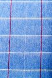 Het wolblauw chekered sjaal op wit stock fotografie