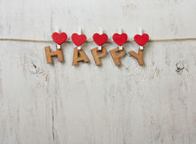 Het woord gelukkig op een witte oude achtergrond Royalty-vrije Stock Afbeeldingen