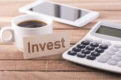Het woord investeert royalty-vrije stock afbeelding