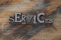 Het woord van de diensten in metaaltype blokken Stock Foto's