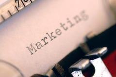 Het woord van de marketing op papier Stock Fotografie