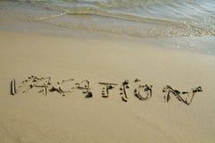 Het woord van de vakantie op het strand Royalty-vrije Stock Afbeeldingen
