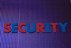 Het woord van de veiligheid op blauwe neonachtergrond Royalty-vrije Stock Afbeelding