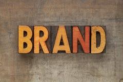 Het woord van het merk in letterzetseltype Stock Fotografie