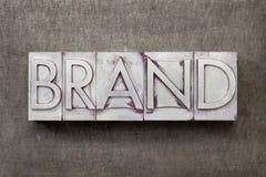 Het woord van het merk in metaaltype Royalty-vrije Stock Afbeeldingen