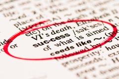 Het woord van het succes duidelijk op rood Royalty-vrije Stock Afbeeldingen