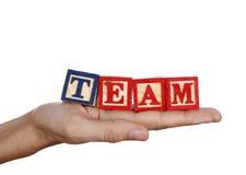 Het woord van het team in een hand Royalty-vrije Stock Afbeelding