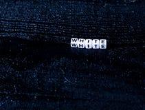 Het woord ` witte die ` van kubussen op een zwarte houten achtergrond wordt gemaakt Zwarte achtergrond royalty-vrije stock foto