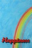 Het woordgeluk met een blauwe hemel en een kleurrijke regenboog Stock Afbeeldingen