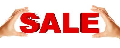 Het woordholding van de verkoop door twee vrouwelijke handen Stock Afbeelding