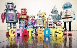 Het woordpraatje BOTS met houten brieven en retro stuk speelgoed robots o royalty-vrije stock afbeelding