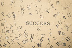 het woordsucces van de alfabetbrief van de doopvont van zegelbrieven op document FO Royalty-vrije Stock Afbeelding