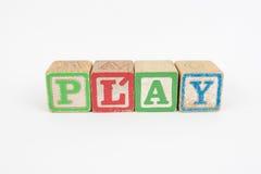 Het Word Spel in de Blokken van Houten Kinderen Stock Foto's