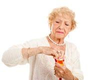 Het worstelen om Pillen te openen Royalty-vrije Stock Fotografie