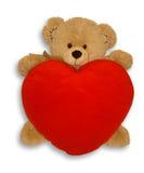 Het zachte stuk speelgoed draagt en hart Stock Foto's
