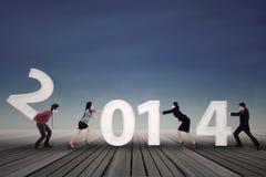 Het zakenlui schikt nieuw jaar 2014 Stock Foto