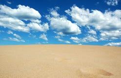 Het zand ontmoet Hemel Stock Foto's