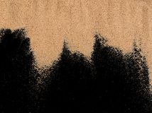 Het zand op de zwarte achtergrond Royalty-vrije Stock Foto