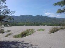 Het zand van de strandkust Stock Afbeeldingen