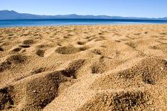 Het Zand van het strand en blauwe hemel Stock Afbeelding