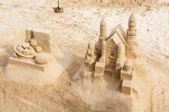 Het zandkasteel van de zandkunst Stock Foto