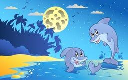 Het zeegezicht van de nacht met twee dolfijnen royalty-vrije illustratie