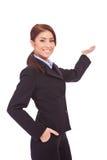 Het zekere bedrijfsvrouw voorstellen stock fotografie