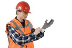 Het zetten op handschoenen Stock Fotografie
