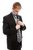 Het zetten op stropdas Stock Foto