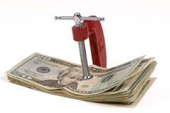 Het zetten van een samendrukking op uw geld 1 Stock Foto