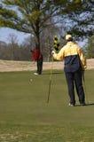 Het zetten van golfspelers Stock Foto's