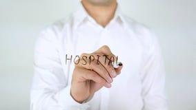 Het ziekenhuis, Zakenman Writing op Glas stock afbeeldingen