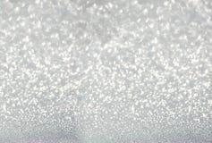 Het zilver defocused schittert achtergrond Royalty-vrije Stock Afbeeldingen