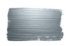 Het zilver schittert de slag van de verfborstel of abstracte scharvlek met smudge textuur op witte achtergrond voor de kaartontwe stock foto