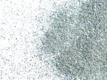 Het zilver schittert fonkeling op witte achtergrond Stock Afbeelding